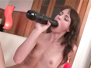 Lewd Brunette Spinner In A Dress With A Huge Dildo
