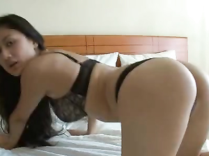 Thong And Bra On A Beautiful Masturbating Asian